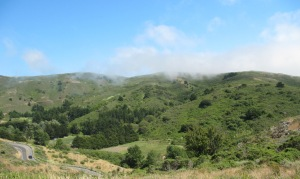 photo of wisps of fog coming over the hills